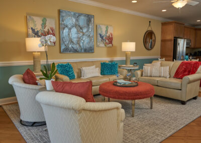 Beach House Living Room brought to life with coastal shades of turquoise and coral in artwork, accessories, and furnishings.